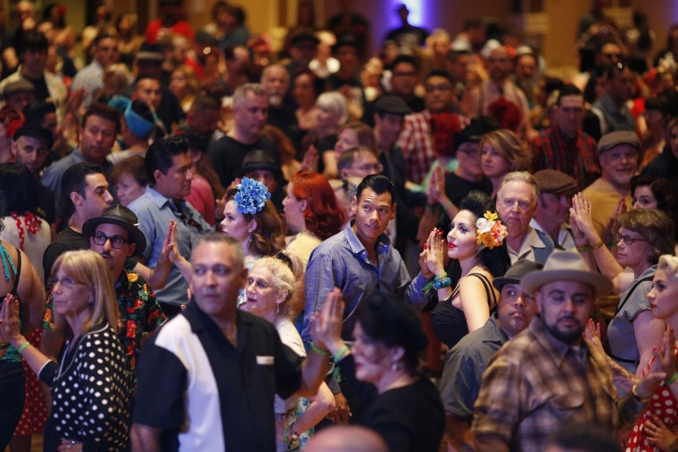 In this April 3, 2015, photo, people crowd the dance floor at a jive dance class during the Viva Las Vegas Rockabilly Weekend in Las Vegas. The event keeps alive dancing and other aspects of the 1950's rockabilly culture. (AP Photo/John Locher)