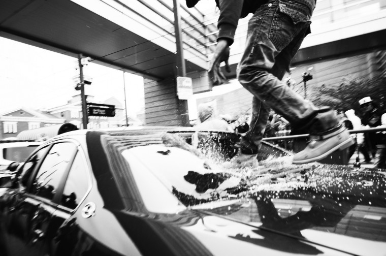 April 25: After a peaceful protest, protesters destroy police cars parked near Camden Yards. See more photos from the day here.