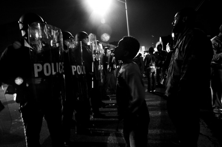 April 26: After a night of looting, the focus of the protests switched back to the Western District Precinct, where protesters taunted police in the early morning hours. See more photos from the day here.