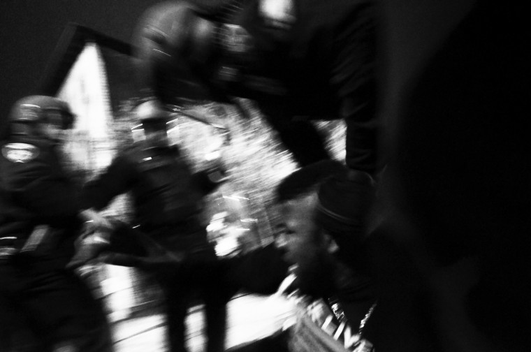 April 26: While on the ground, City Paper photographer J.M. Giordano kept photographing and caught this encounter between police and a protester. See more photos from the day here.