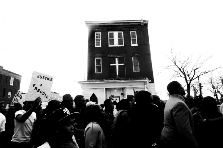 April 21: Hundreds gather at the Western District precinct for a peaceful vigil and march in memory of Freddie Gray. BCPD tweet: #PCBatts meets with residents in Gilmor Homes after yesterday's commitment to maintain a strong… See more photos from the day here.