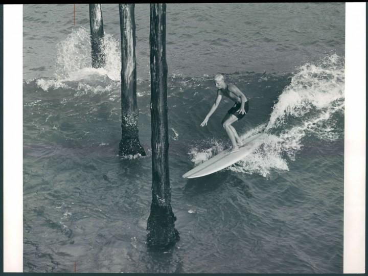 Surfer at pier, 1964.