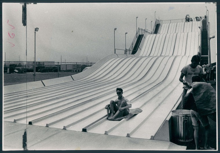 The Finish Line: A rider finished his rolling slide atop burlap riding mat, 1968.
