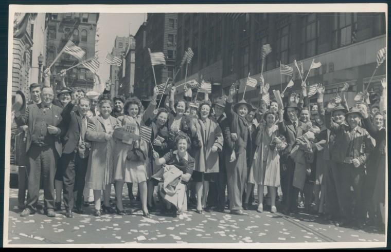 Crowds in Baltimore celebrate near Sun Square with flags and confetti. (Baltimore Sun archives)