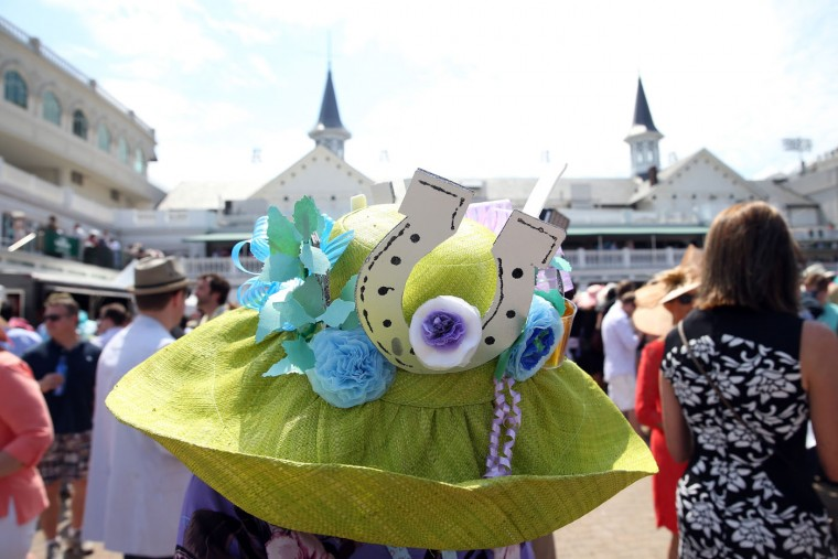 A woman wearing a festive hat looks on prior to the 141st running of the Kentucky Derby at Churchill Downs on May 2, 2015 in Louisville, Kentucky. (Andy Lyons/Getty Images)