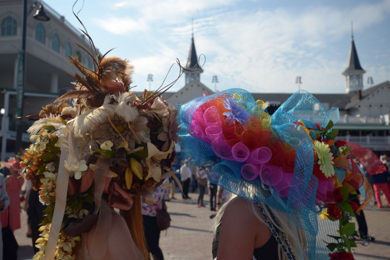 Women wearing a festive hats look on prior to the 141st running of the Kentucky Derby at Churchill Downs on May 2, 2015 in Louisville, Kentucky. (Dylan Buell/Getty Images)