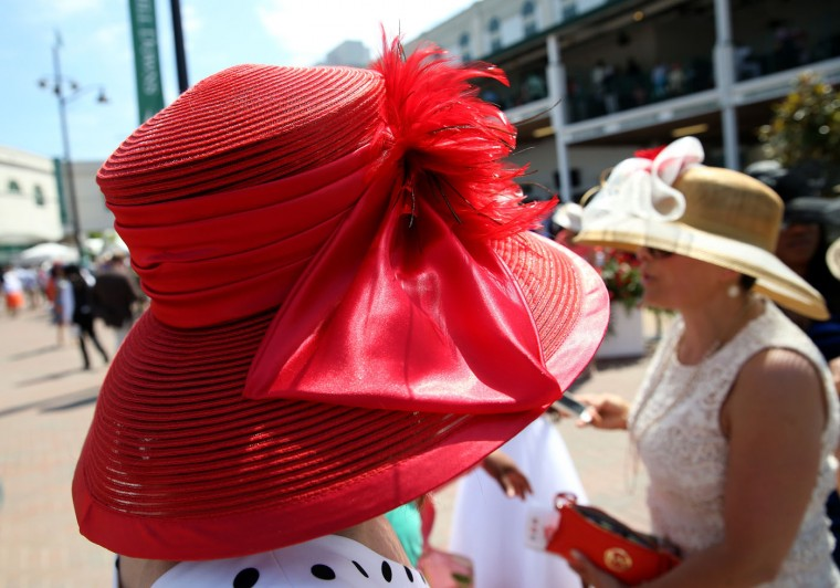 Women wearing a festive hats look on prior to the 141st running of the Kentucky Derby at Churchill Downs on May 2, 2015 in Louisville, Kentucky. (Andy Lyons/Getty Images)
