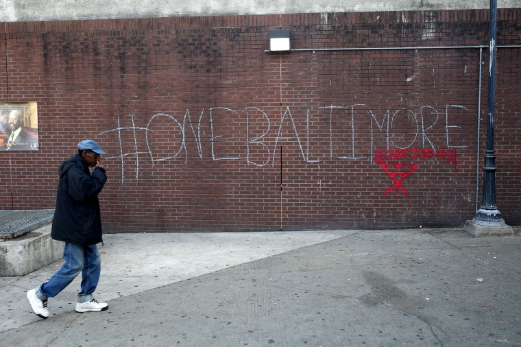05/2015: A man walks by a tagging reading 'One Baltimore' on the corner of North Ave., and Pennsylvania Ave., a day after Baltimore authorities released a report on the death of Freddie Gray on May 2, 2015 in Baltimore, Maryland. Marilyn Mosby, Baltimore City state's attorney, ruled the death of Freddie Gray a homicide and that criminal charges will be filed on six Baltimore City Police officers. Gray, 25, was arrested for possessing a switch blade knife April 12 outside the Gilmor Houses housing project on Baltimore's west side. According to his attorney, Gray died a week later in the hospital from a severe spinal cord injury he received while in police custody. (Photo by Patrick Smith/Getty Images)