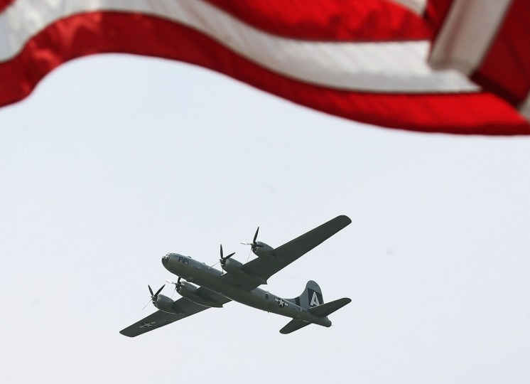 A vintage World War II B29 bomber flies down the National Mall May 8, 2015 in Washington, DC. Fifty-six vintage war planes took part in a flyover near the WWII memorial for the 70th anniversary Victory in Europe celebration. (Photo by Mark Wilson/Getty Images)