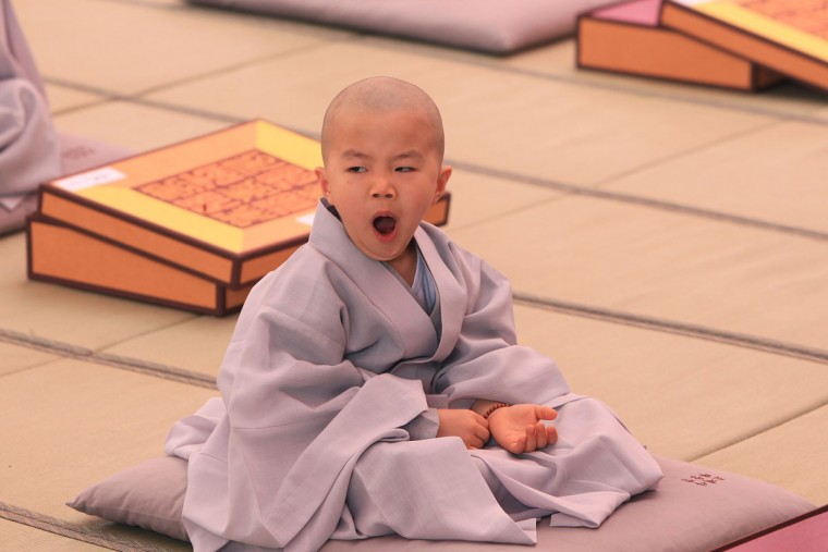 A child attends during the 'Children Becoming Buddhist Monks' ceremony forthcoming buddha's birthday at a Chogye temple on May 11, 2015 in Seoul, South Korea. Children have their hair shaved off during the 'Children Becoming Buddhist Monks' ceremony ahead of buddha's birthday at a Chogye temple. The children will stay at the temple to learn about Buddhism for 14 days. Buddha was born approximately 2,559 years ago, and although the exact date is unknown, Buddha's official birthday is celebrated on the full moon in May in South Korea, which is on May 25 this year. (Photo by Chung Sung-Jun/Getty Images)