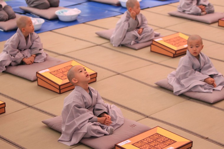 Children attend during the 'Children Becoming Buddhist Monks' ceremony forthcoming buddha's birthday at a Chogye temple on May 11, 2015 in Seoul, South Korea. Children have their hair shaved off during the 'Children Becoming Buddhist Monks' ceremony ahead of buddha's birthday at a Chogye temple. The children will stay at the temple to learn about Buddhism for 14 days. Buddha was born approximately 2,559 years ago, and although the exact date is unknown, Buddha's official birthday is celebrated on the full moon in May in South Korea, which is on May 25 this year. (Photo by Chung Sung-Jun/Getty Images)