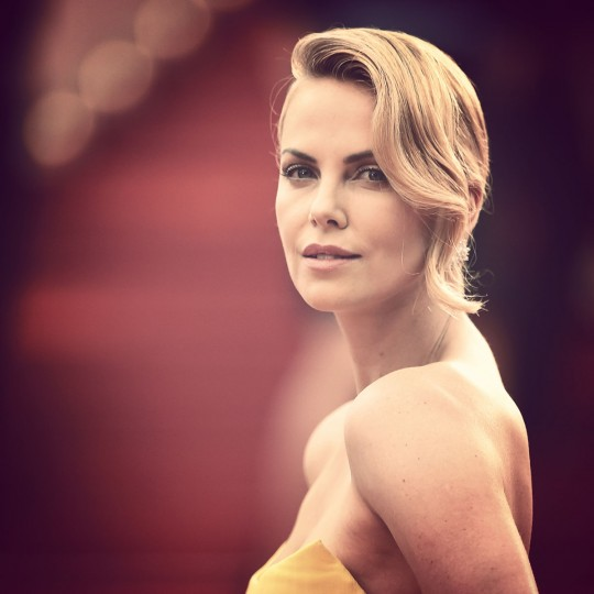 """Charlize Theron attends Premiere of """"Mad Max: Fury Road"""" during the 68th annual Cannes Film Festival on May 14, 2015 in Cannes, France. (Photo by Pascal Le Segretain/Getty Images)"""