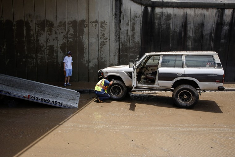 Diego Singleton's vehicle sits on Allen Parkway, the last remaining vehicle to be towed from underneath the Montrose Blvd. overpass following massive flooding May 27, 2015 in Houston, Texas. At least 19 people have been killed across Texas and Oklahoma after severe weather, including catastrophic flooding and tornadoes, struck over the past several days, with more rain expected. (Photo by Eric Kayne/Getty Images)