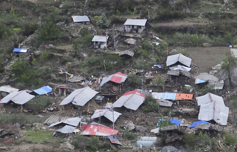This aerial picture taken on April 27, 2015 shows damaged houses in a village in Jilong, southwest China's Tibet region in the aftermath of an earthquake that hit Nepal on April 25. Hundreds of thousands of Nepalis spent another night in the open on April 27 after a massive quake which killed more than 4,000, as officials warned the final toll could rise sharply once rescuers reach cut-off areas. (China Out)