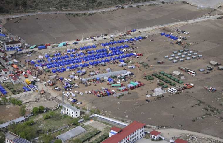 This aerial picture taken on April 27, 2015 shows temporary tents being set up for earthquake victims in Jilong, southwest China's Tibet region. Hundreds of thousands of Nepalis spent another night in the open on April 27 after a massive quake which killed more than 4,000, as officials warned the final toll could rise sharply once rescuers reach cut-off areas. (China Out)