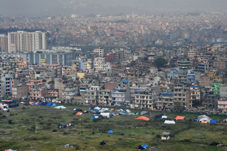 In this aerial view residents of Nepal's capital Kathmandu stand next to their tents in a field near the airport on April 29, 2015. Rescuers are facing a race against time to find survivors of a mammoth earthquake that killed more than 5,000 people when it through Nepal five days ago and devastated large parts of one of Asia's poorest nations. (Roberto Schmidt/AFP/Getty Images)