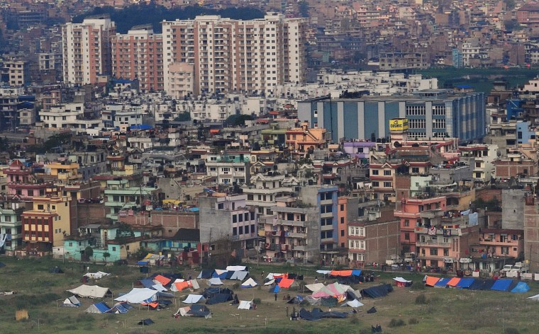This aerial view shows temporary shelters set up in a field near the airport in Nepal's capital Kathmandu on April 29, 2015 in response to fear of further collapse in after shock of a major earthquake that severely hit the area on April 25. Rescuers are facing a race against time to find survivors of a mammoth earthquake that killed more than 5,000 people when it through Nepal five days ago and devastated large parts of one of Asia's poorest nations. (Roberto Schmidt/AFP/Getty Images)
