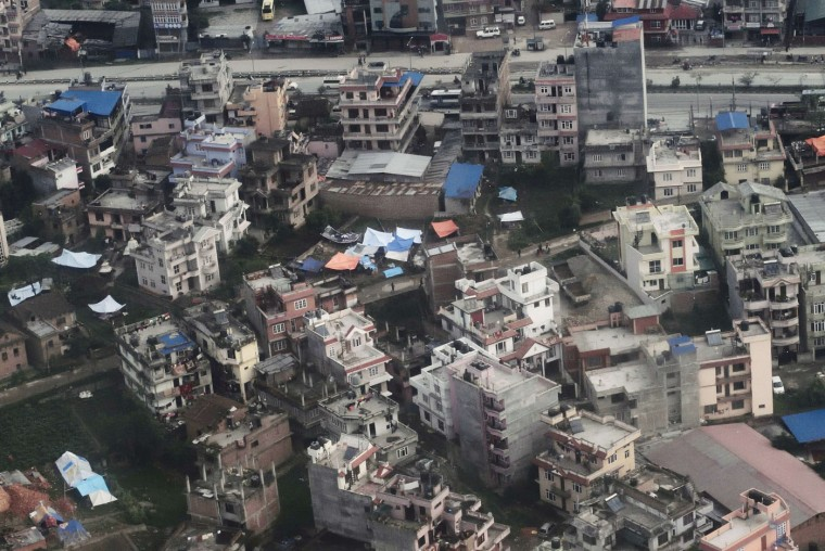 In this aerial view tents crowd an empty space between buildings in Nepal's capital Kathmandu on April 29, 2015, in response to fear of further collapse in after shock of a major earthquake that severely hit the area on April 25. Rescuers are facing a race against time to find survivors of a mammoth earthquake that killed more than 5,000 people when it through Nepal five days ago and devastated large parts of one of Asia's poorest nations. (Roberto Schmidt/AFP/Getty Images)