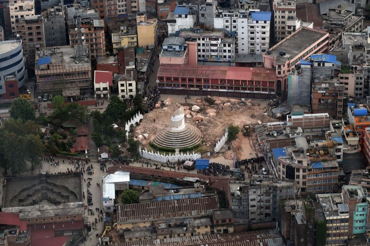An aerial view of damaged Dharahara tower in Kathmandu on April 29, 2015, which was reduced to rubble in a devastating earthquake on April 25. Desperate Nepalis clashed with riot police and seized supplies of bottled water in the capital April 29 as anger boiled over among survivors of an earthquake that killed more than 5,000 people. (Prakash Singh/AFP/Getty Images)
