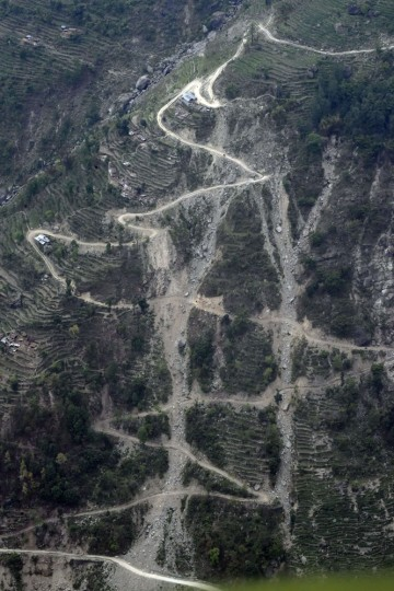 An aerial picture taken on May 7, 2015 shows landslides that were triggered by an earthquake in Nepal in a valley leading up to the wiped out village of Langtang in north-central Nepal. Helicopters are the main form of transport for international aid as they can carry it to people living in remote areas. The earthquake that struck Nepal on April 25, 2015, killed more 7,600 people and nearly 300,000 homeless. (Roberto Schmidt/AFP/Getty Images)
