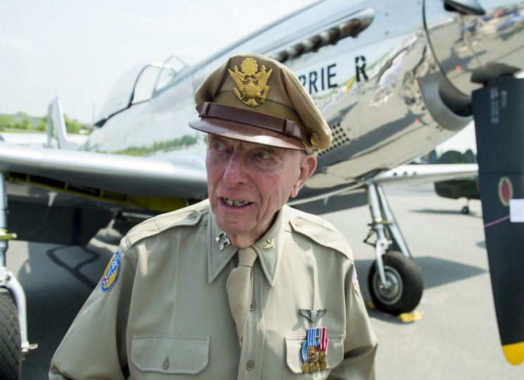 World War II veteran Jerry Yellin, a former P51 fighter pilot, stands in front of a P51 airplane as dozens of World War II era aircraft gather at Culpeper Regional Airport in Brandy Station, Virginia, May 7, 2015. The planes will fly past the National Mall in Washington, DC, on May 8, during the Arsenal of Democracy World War II Victory Capitol Flyover to commemorate the 70th anniversary of Victory in Europe (VE) Day. Yellin flew in the last combat mission over Japan. (Saul Loeb/AFP/Getty Images)