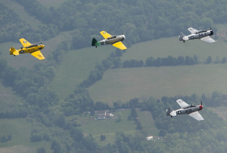 World War II era trainer aircraft practice formation flying over Culpeper Regional Airport in Brandy Station, Virginia, May 7, 2015. The planes will fly past the National Mall in Washington, DC, on May 8, during the Arsenal of Democracy World War II Victory Capitol Flyover to commemorate the 70th anniversary of Victory in Europe (VE) Day. (Saul Loeb/AFP/Getty Images)