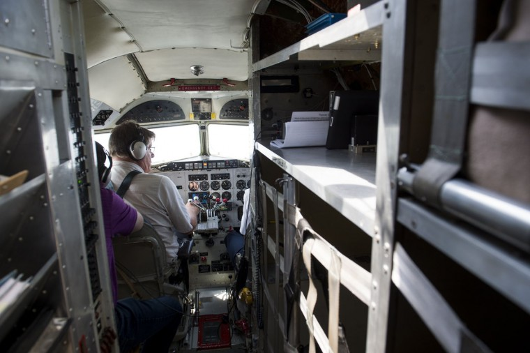 Pilot and owner Karl Stoltzfu flies a Douglas C-47 Skytrain airplane during a practice flight with dozens of World War II era aircraft near Culpeper Regional Airport in Brandy Station, Virginia, May 7, 2015. Dozens of World War II era planes will fly past the National Mall in Washington, DC, on May 8, during the Arsenal of Democracy World War II Victory Capitol Flyover to commemorate the 70th anniversary of Victory in Europe (VE) Day. (Saul Loeb/AFP/Getty Images)