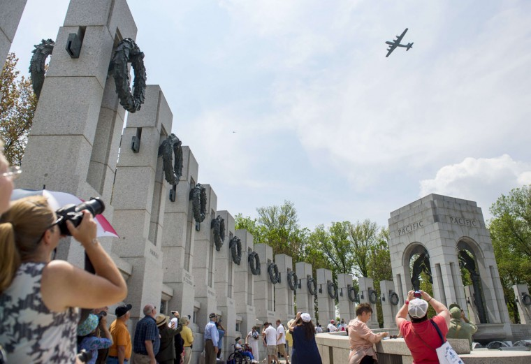 A Boeing B-29 Superfortress flies over the National World War II Memorial on the National Mall in Washington, DC, May 8, 2015, during the Arsenal of Democracy World War II Victory Capitol Flyover to commemorate the 70th anniversary of Victory in Europe (VE) Day. (Saul Loeb/AFP/Getty Images)