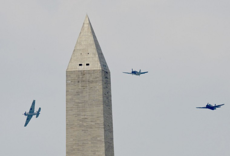 WWII-era planes fly over the Washington Monument during the Arsenal of Democracy, a WWII plane flyover for the 70th anniversary of V-E Day in Washington, DC, on May 8 2015. (Andrew Caballero-Reynolds/AFP/Getty Images)