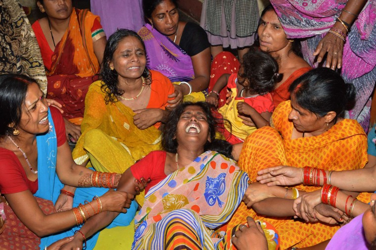 An Indian widow (C) is comforted by relatives and friends after the death of her husband on the outskirts of Patna on May 12, 2015, after a new 7.3 earthquake and several powerful aftershocks hit neighbouring devastated Nepal. A new earthquake and powerful aftershocks killed dozens of people and brought fresh terror to a traumatised Nepal as buildings already damaged in a monster quake last month came tumbling down. Officials in Nepal said at least 36 people were killed while 17 people also died across the border in northern India, most in the state of Bihar. (AFP Photo/P /strstrdel/afp/getty )