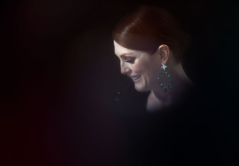 US actress Julianne Moore laughs on the set of the Grand Journal tv show, on the sidelines of the 68th Cannes Film Festival in Cannes, southeastern France, on May 13, 2015. (AFP Photo/Loic Venance)