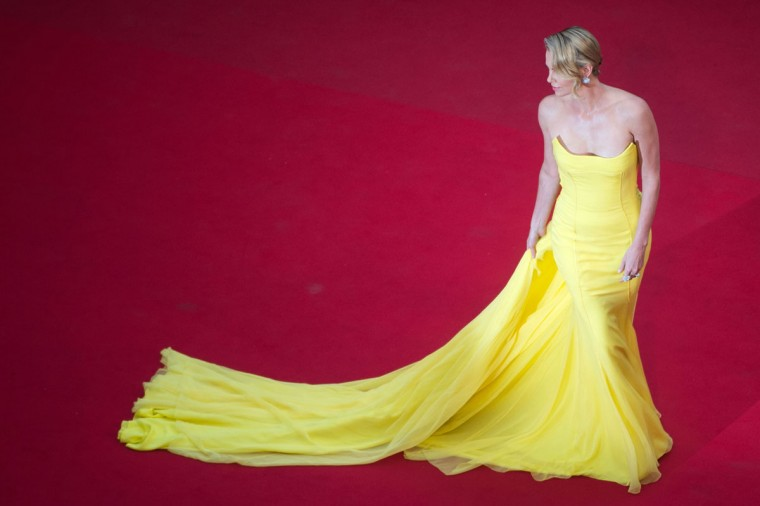 "Charlize Theron poses as she arrives for the screening of the film ""Mad Max : Fury Road"" during the 68th Cannes Film Festival in Cannes, southeastern France, on May 14, 2015. (BERTRAND LANGLOIS/AFP/Getty Images)"