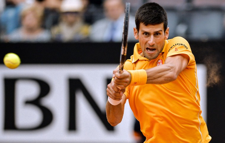 Novak Djokovic of Serbia returns the ball to Kei Nishikori of Japan during their ATP Tennis Open match in Rome on May 15, 2015. (ANDREAS SOLARO/AFP/Getty Images)