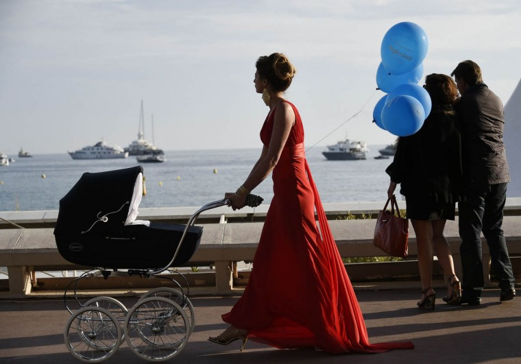 A model takes part in a photoshoot on the Croisette during the 68th Cannes Film Festival in Cannes, southeastern France, on May 19, 2015. (Loic Venance/Getty Images)
