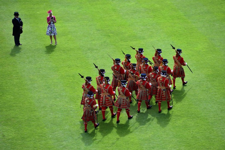 Yeomen of the Guard march during a garden party in the grounds of Buckingham Palace in central London, May 20, 2015. (Ben Stansall/Getty Images)
