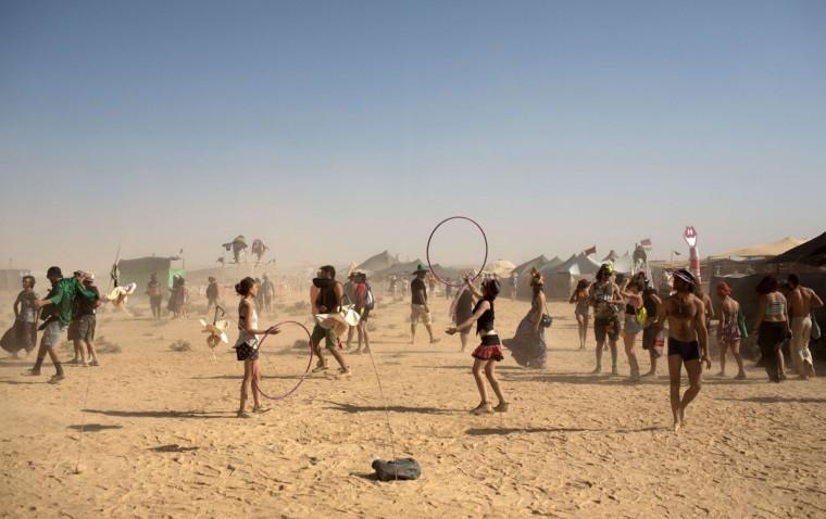 Israelis dance during the 2015 Midburn festival in the Negev Desert near the Israeli kibbutz of Sde Boker on May 21, 2015. (MENAHEM KAHANA/AFP/Getty Images)