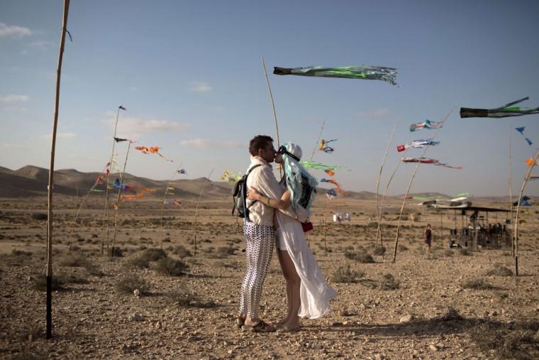 A couple kiss during the 2015 Midburn festival in the Negev Desert near the Israeli kibbutz of Sde Boker on May 21, 2015. (MENAHEM KAHANA/AFP/Getty Images)