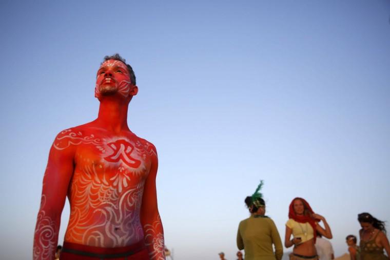 Israelis dance during the 2015 Midburn festival in the Negev Desert near the Israeli kibbutz of Sde Boker on May 23, 2015. (GALI TIBBON/AFP/Getty Images)