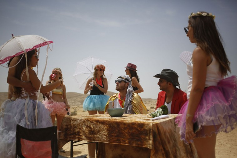 "Israelis line up at the ""office of bad advice"" during the 2015 Midburn festival in the Negev Desert near the Israeli kibbutz of Sde Boker on May 23, 2015. (GALI TIBBON/AFP/Getty Images)"
