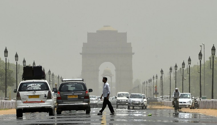 A mirage shimmers over Raphath leading to India Gate in New Delhi on May 28, 2015. More than 1,100 people have died in a blistering heatwave sweeping India, authorities said, as forecasters warned searing temperatures would continue. (Chandan Khanna/AFP/Getty Images)