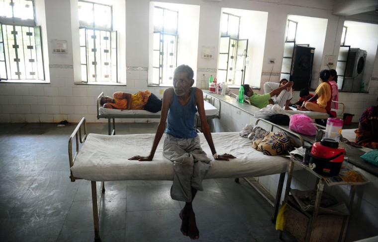 Indian diarrhoea patient Munawar Ali sits on a bed in a government hospital in Allahabad on May 28, 2015, as scorching weather conditions continue across India. Hospitals in India were struggling to cope with an influx of victims of a blistering heatwave that has claimed nearly 1,500 lives in just over a week. (Sanjay Kanojia/AFP/Getty Images)