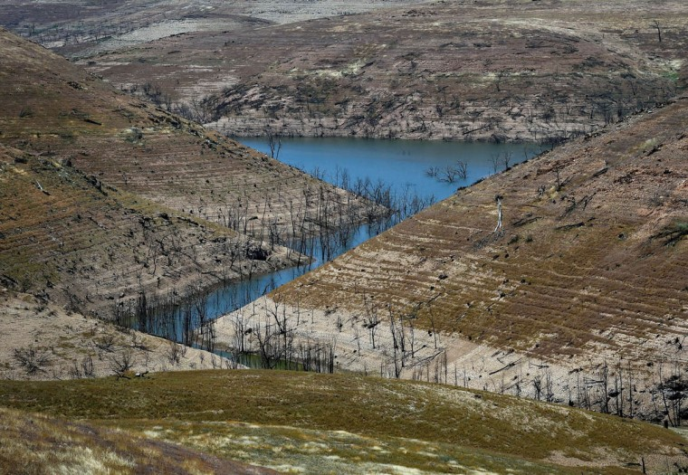 Water is seen at the bottom of the New Melones Lake reservoir which is now at less than 20 percent capacity as a severe drought continues to affect California on May 26, 2015. California has recently announced sweeping statewide water restrictions for the first time in history in order to combat the region's devastating drought, the worst since records began. (Mark Ralston/AFP/Getty Images)