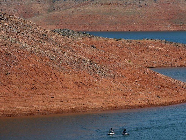 Kayakers paddle on the Oroville Lake reservoir which is now at less than 25 percent capacity as a severe drought continues to affect California on May 24, 2015. California has recently announced sweeping statewide water restrictions for the first time in history in order to combat the region's devastating drought, the worst since records began. (Mark Ralston/AFP/Getty Images)