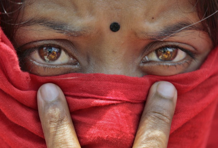 A worker of the recently closed Swan garments factory covers her face with a scarf to shelter herself from the sun as she participates in a protest outside the Bangladesh Garment Manufacturers and Export Association (BGMEA) office in Dhaka, Bangladesh, Monday, May 4, 2015. More than two hundred workers protested Monday demanding payment of wages still owed to them as well as reopening of the manufacturing unit. Bangladesh is the world's second-largest garment manufacturing country after China. The sector employs about 4 million workers, mostly women. (AP Photo/A.M. Ahad)