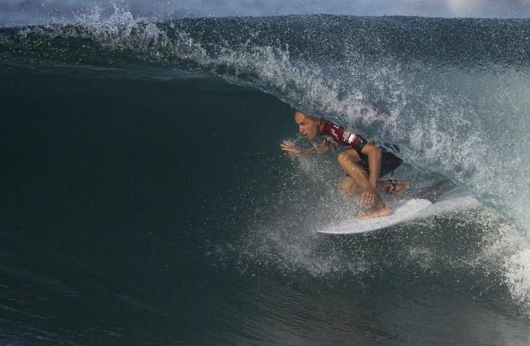 U.S. surfer Kelly Slater competes in the 2015 Oi Rio Pro World Surf League competition at Barra da Tijuca beach in Rio de Janeiro, Brazil, Tuesday, May 12, 2015. (AP Photo/Leo Correa)
