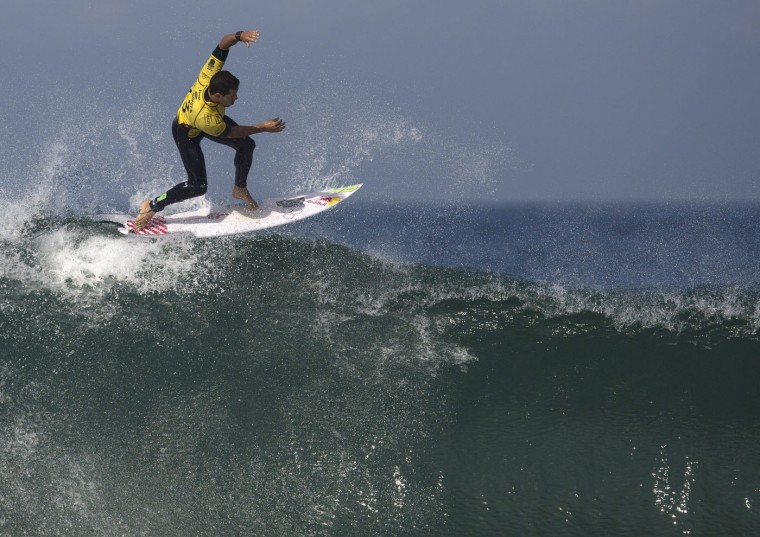 Brazil's Adriano de Souza competes in the 2015 Oi Rio Pro World Surf League competition at Barra da Tijuca beach in Rio de Janeiro, Brazil, Tuesday, May 12, 2015. (AP Photo/Leo Correa)