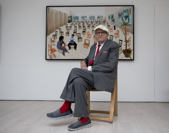 """British artist David Hockney poses for photographers in front of his photographic drawing printed on paper """"The Chairs"""" which features as part of the """"David Hockney Painting and Photography"""" exhibition at the Annely Juda Fine Art gallery in London, Thursday, May 14, 2015. The show, which runs from May 15 to June 27, is an exploration of Hockney's interest in perspective and features a series of portraits, including his American friends playing cards, and other scenes painted in his Los Angeles studio in 2014 and 2015. (AP Photo/Matt Dunham)"""