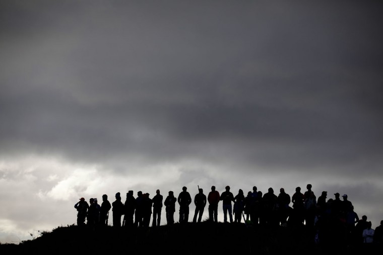 Golf fans wait for Northern Ireland's Rory McIlroy during round one of the Irish Open Golf Championship at Royal County Down, Newcastle, Northern Ireland, Thursday, May 28, 2015. (AP Photo/Peter Morrison)