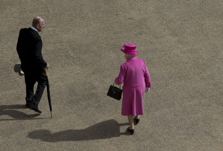 Britain's Queen Elizabeth II, and Prince Philip make their way towards a garden party, held at Buckingham Palace in London, Thursday, May 28, 2015. (AP Photo/Alastair Grant, Pool)