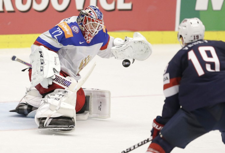 Russiaís goalkeeper Sergei Bobrovski, left, saves a shot by Jimmy Vesey of USA, right, during the Hockey World Championships Group B match in Ostrava, Czech Republic, Monday, May 4, 2015. (AP Photo/Sergei Grits)